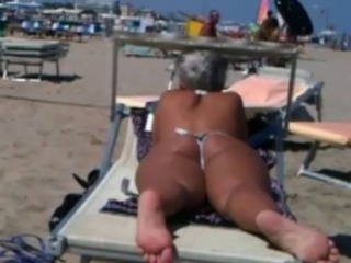 Big ass milf on the beach