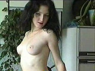 Lady in red stripping in kitchen