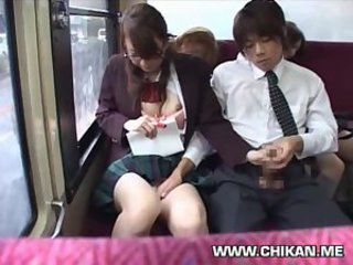 Schoolgirl manufactured handjob in a bus