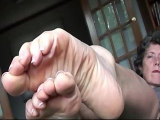 Hypnotic bare feet & soles near oral script