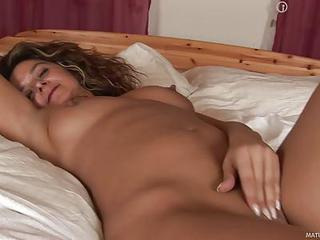 Alluring Milf Emanuelle Is Finally In Her Bed After Night Out. She Is Naked And Enjoys Relaxing Masturbation Session. She Rubs Her Juicy Mature Pussy In The Middle Of The Bed And Shows Off Her Nice Body.