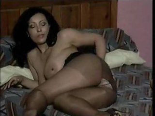 Mature pantyhose model is stripping lustily