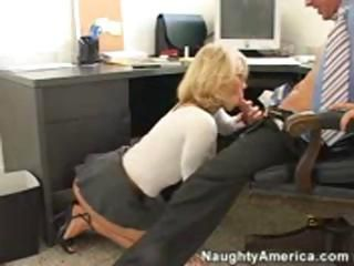 Blonde Katie Morgan is on her knees sucking and then fucks in the office