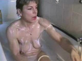 Mature slut masturbating in bathtub
