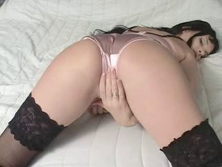 Girl rubbing herself through satin panties