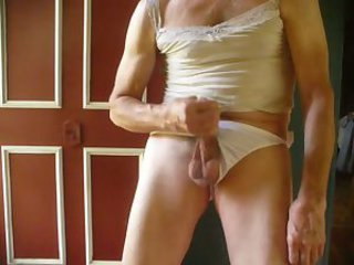 Male lingerie whore has an orgasm by the open front door.