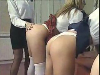 Three schoolgirls present for headmistress
