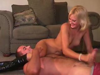 Dominant boots girl strokes his big cock