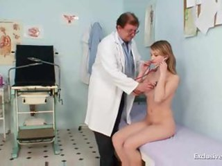 Her pussy is examined by the doctor