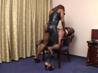 Black  Mistress fucks dude with strapon