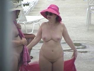 Nude Lady showering outside...