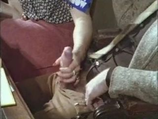 Guy gets a handjob in a retro...
