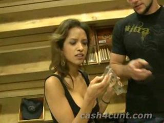 Slutty brunette is approached in a cigar shop and offered cash to flash her tits and give a guy a handjob and the greedy skank asks for even more money before her hands even touch the guys cock