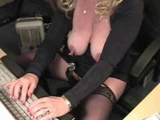 Horny grandma with enormously giant clit has fun at computer