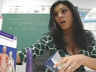 Hot teacher poking her slit with huge purple dildo