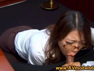 Asian babe secretary deepthroating cock in the office