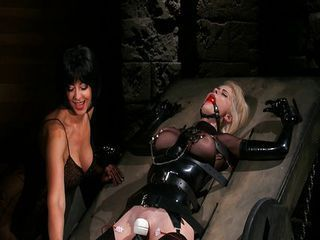 Latex Girl is captive of cruel Dykes
