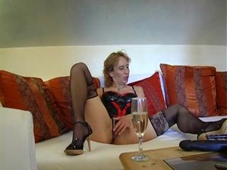 German woman in black stockings enjoys to masturbate