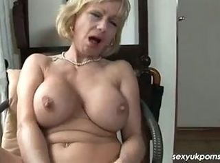 Mature British pornstar Jane Bond unattended in the study