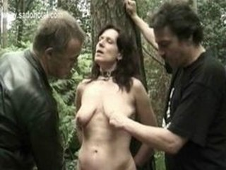 Horny slave is tied to a tree forth the addition of fucked forth a dildo and...