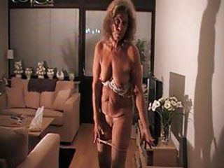 Granny wears pantyhose and teases her pussy tubes