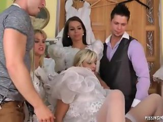 Girls try on wedding dresses and piss
