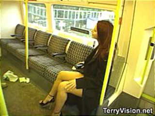 Brunette is on a public train and flashing while others watch