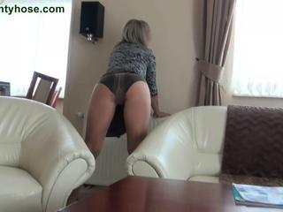 Luring blonde momma upon pantyhose does striptease act