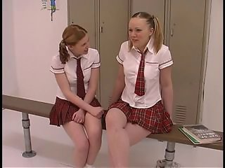 Two teen tarts in schoolgirl uniforms get their freak on in the locker room