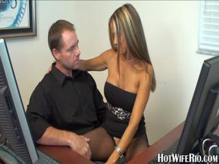 Busty blonde secretary in fishnet stockings gives head in of...