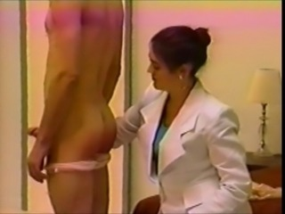 Man in bloomers spanked by businesswoman