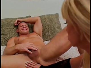 She bends him over and plugs his ass