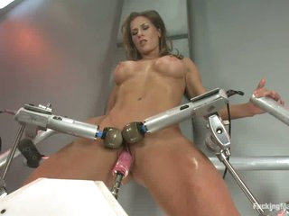 Big racked sporty brunette Ariel X is naked and enjoys crazy sex with fucking machines. She gets her her vagina dildoed and her clit double vibrated before she takes heavy fake cock in her ass.