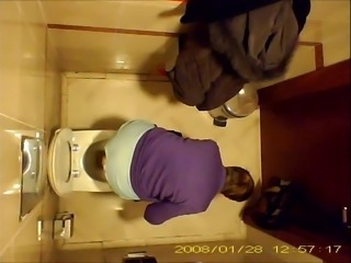 Grandma pees, after stealing the toilet paper