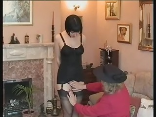 Bossy Mature Lady Reprimands Young Maid in a Girdle and Stockings