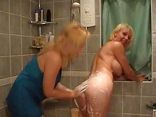 Sexy blonde mommas with great tits having fun in bathroom