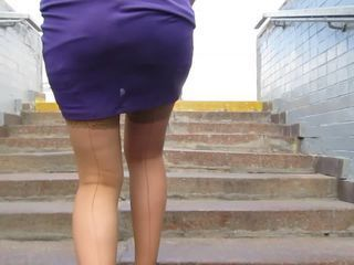 Girl in seameg stockings going upstairs