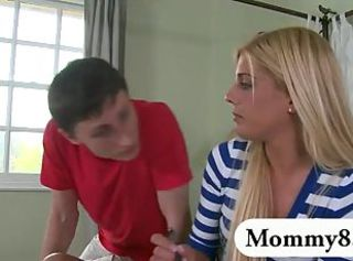 Mature stepmom shows teen how to ride a dick