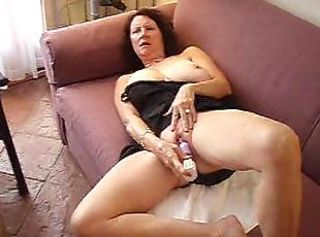Sexy Aunt Sally masturbates on camera