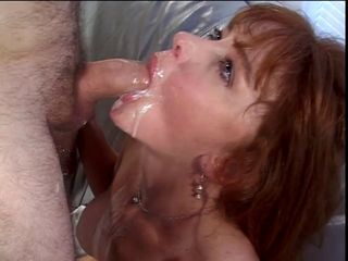 Busty brunette MILF gags on h...