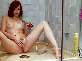 Leila Smith Is A Skinny European Redhead With Tiny Tits And Bald Pussy. This Young Babe Spreads Her Sexy Slender Legs And Showers Her Snatch. Leila Smith Loves Masturbating Under The Running Water.