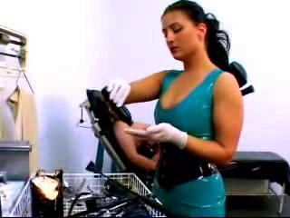 Girl In Corset Tied To Medical Chair Getting Her Pus...