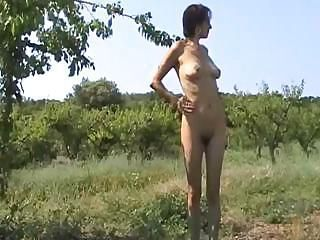 Middle-aged female with hairy pussy takes a leak and then fucks with her lover