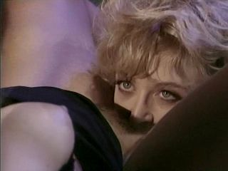 KC Williams and Nina Hartley in a threesome