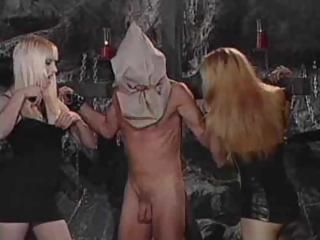 Three babes tie up this dude and torture him in the dungeon