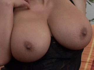 Redheaded mom showing her superhuge tits