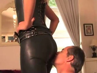 Slave worshipping his leather loving domina
