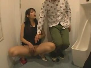 Honey brunette masturbate in a toilet