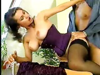 Retro Pornstar In A Tight Purple Corset Fucked