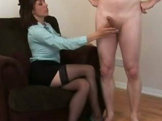 Bad girl toys and plays with poor naked guys cock